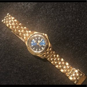 Gold Ladies Citizen watch with teal color face